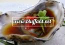 Ostra con salsa ponzu y brotes de daikon
