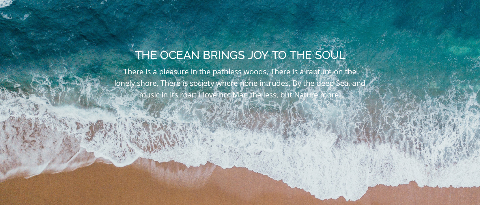 "Blue ocean was thing up on to the beach with text ""The Ocean Brings Joy to the Soul"""