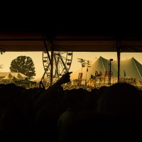 Looking out to the tent and ferris whell from a pavilliion at Bonnaroo. June, 2007. | Blurbomat.com