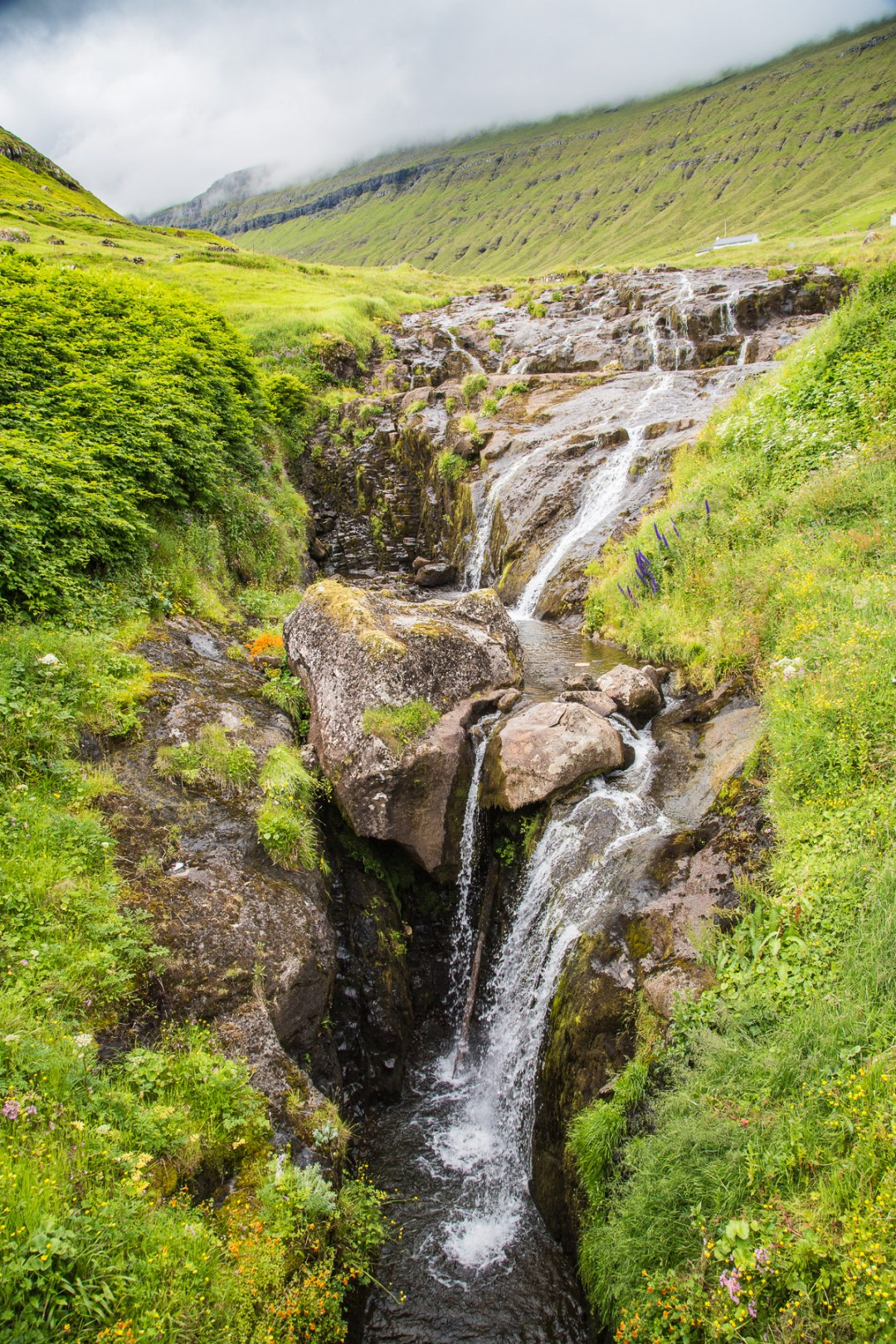 A waterfall just outside Fuglafjørður, Faroe Islands. by Jon Armstrong for Blurbomat.com.