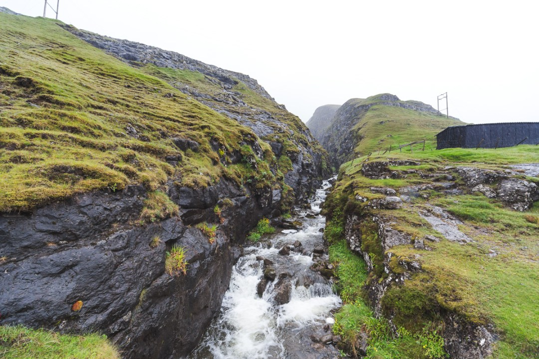 Rainy waterfall near Leypannagjogv, Faroe Islands. by Jon Armstrong for Blurbomat.com.