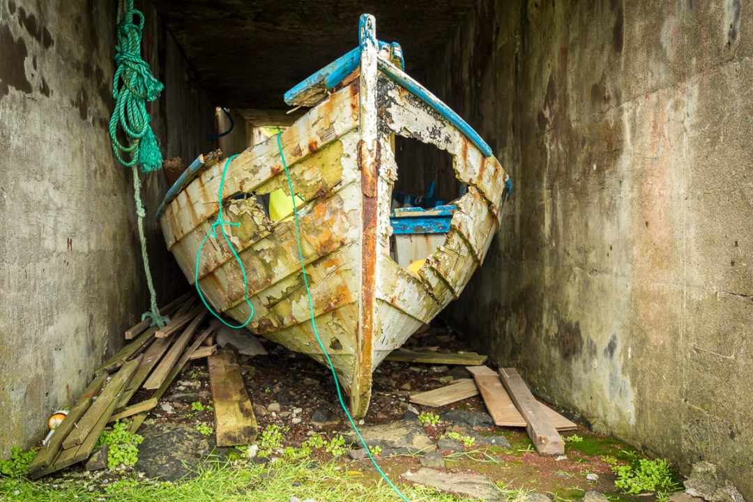 Image of a damaged boat on Suduroy, Faroe Islands.
