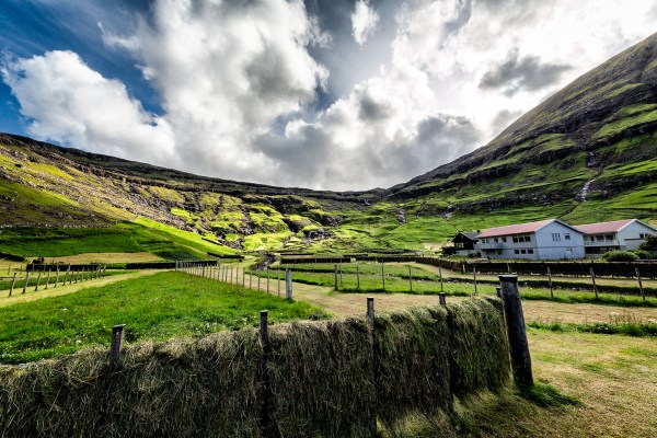 The clouds break stunningly above Tjørnuvík, casting a glorious light across the village. Faroe Islands, July 15, 2014.