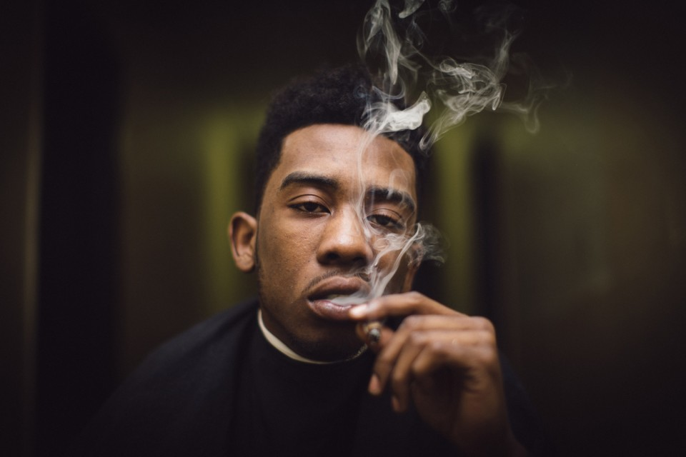 Desiigner smoking a cigarette (or weed)