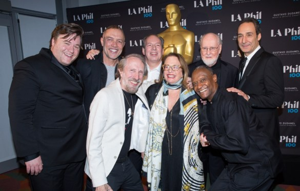 """The Academy presented """"The Oscar Concert"""" on Thursday, February 28, at the Walt Disney Concert Hall in Los Angeles. Pictured (left to right): Benjamin Wallfisch, Michael Abels, Charles Bernstein, Hans Zimmer, Laura Karpman, Thomas Wilkins, John Williams and Alexandre Desplat. Photo by Paul Hebert/ (C) A.M.P.A.S. Used with permission."""