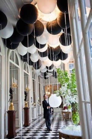 A B&W wedding with lots of balloons