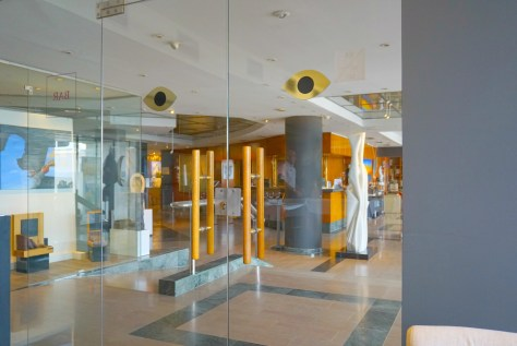 Doors of the Iris Restaurant looking into the lobby of the Estela Hotel in Sitges, Spain