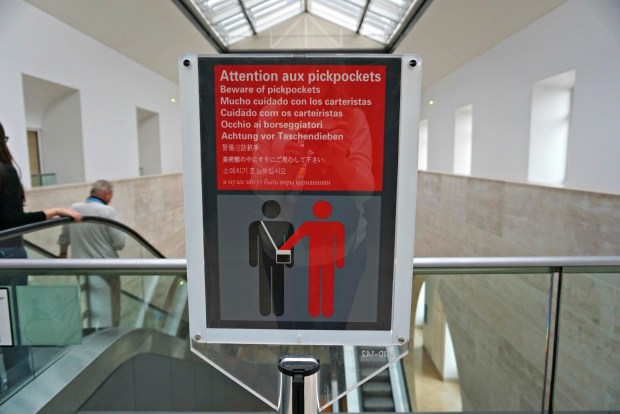 Pickpocket warning sign at the Louvre in Paris