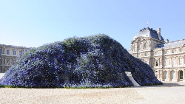 Purple flower wall Dior runway show at the Louvre Paris fashion week