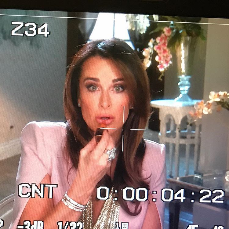 Kyle Richards wearing Tom Ford Spanish Pink Lipstick in a pink outfit for a Real Housewives of Beverly Hills confessional.