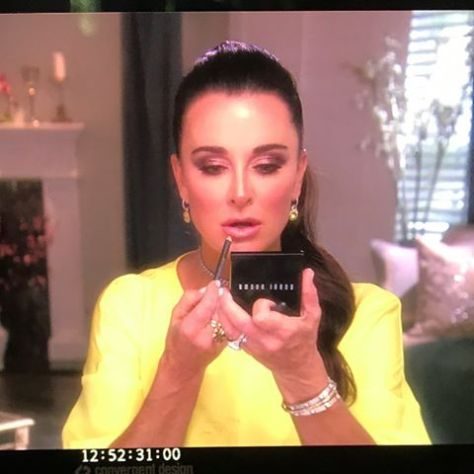 A behind the scenes shot from a yellow interview look worn by Kyle Richards of Real Housewives of Beverly Hills. Product breakdown and photo by @glambypamelab on Instagram.