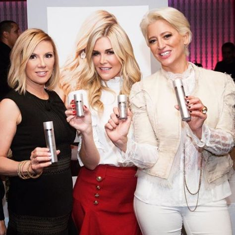 Ramona Singer, Tinsley Mortimer, and Dorinda Medley of Real Housewives of New York City holding Ramona's brand new AGELESS by Ramona skin care line.