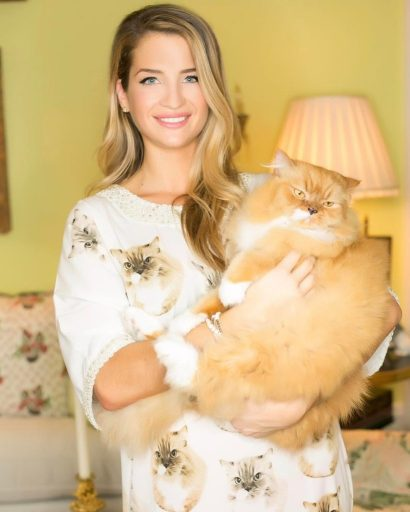 Naomie Olindo wearing a Patricia's Couture Custom Pet Caftan with Gizmo's face printed all over it.