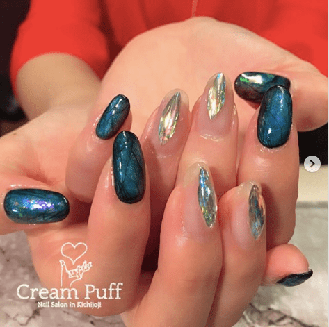 Labradorite crystal nail design with blue crystals and holographic crystals