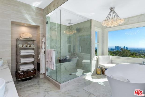 Dorit Kemsley of Real Housewives of Beverly Hills master bathroom has a gorgeous view of Los Angeles, but no home hair salon.