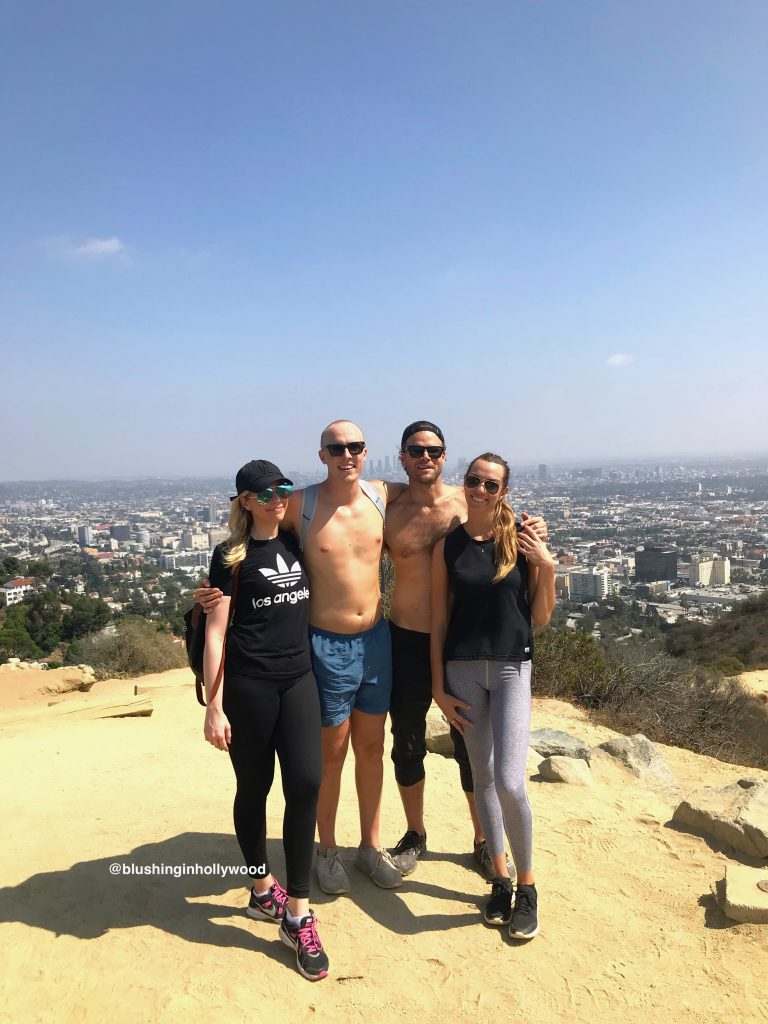 My siblings and I at the top of Runyon Canyon. They like to call me Security because Im always in all black like this.