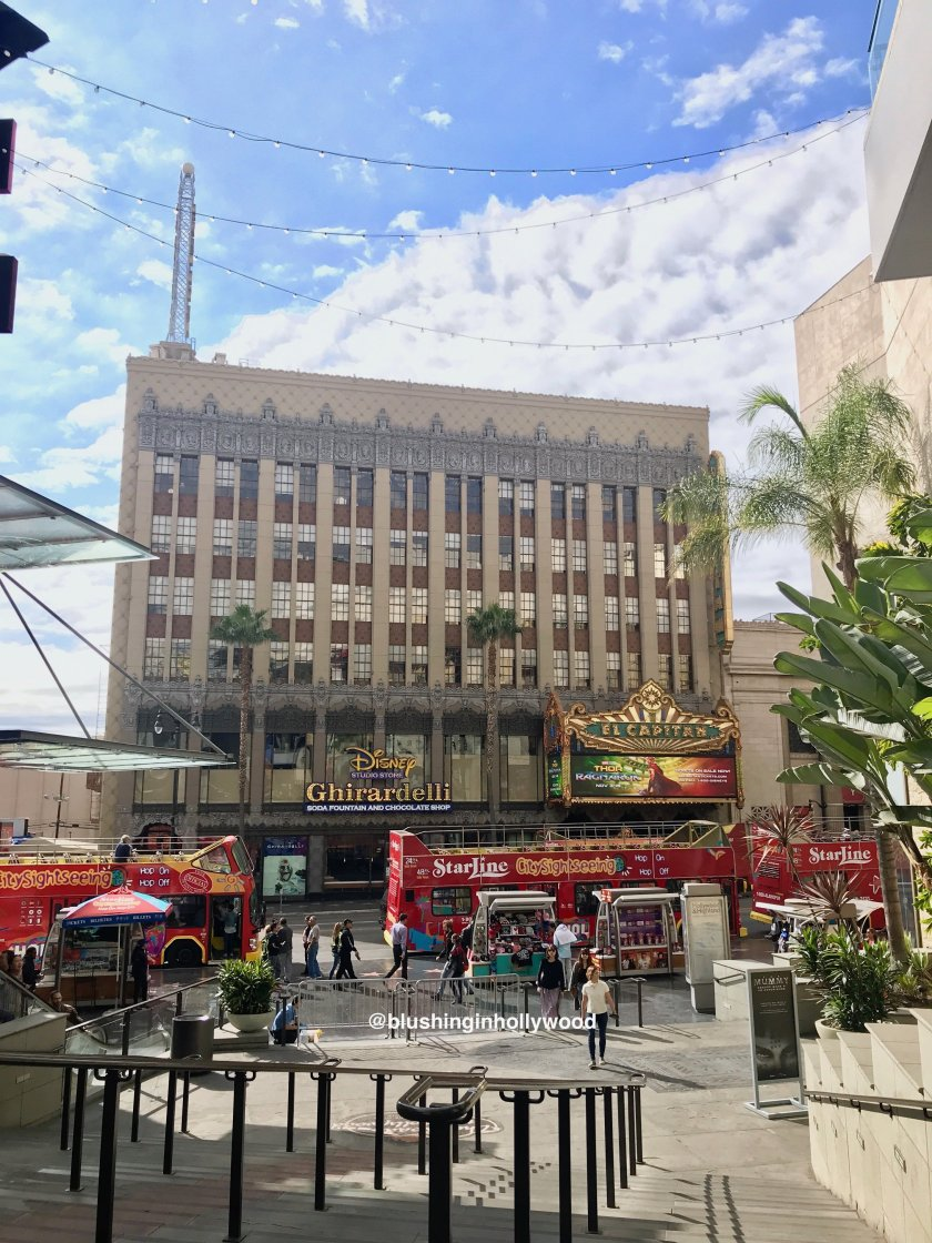 View of Hollywood Blvd, El Capitan Movie Theater, Disney Ghiradelli Store from the Hollywood and Highland Center in Los Angeles, CA