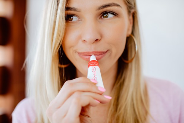 Blushing in Hollywood applying Kopari Lip Glossy resized