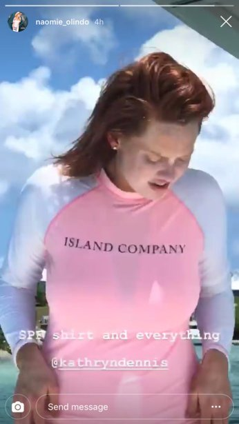 Kathryn Dennis wearing an Island Company swim shirt in the bahamas