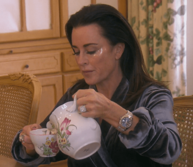 Kyle Richards of Real Housewives of Beverly Hills wearing eye patches at breakfast in Provence