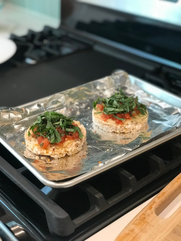 Rice Cakes with Vegan Cheese Trader Giotto's Bruschetta Sauce and fresh basil