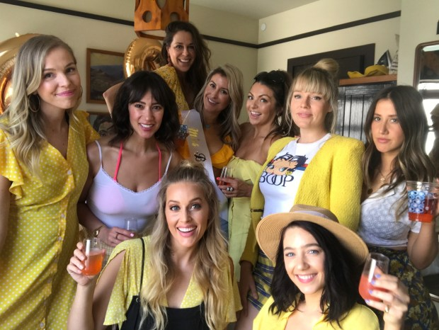 All the girls in Jessica's favorite color yellow for her bachelorette party