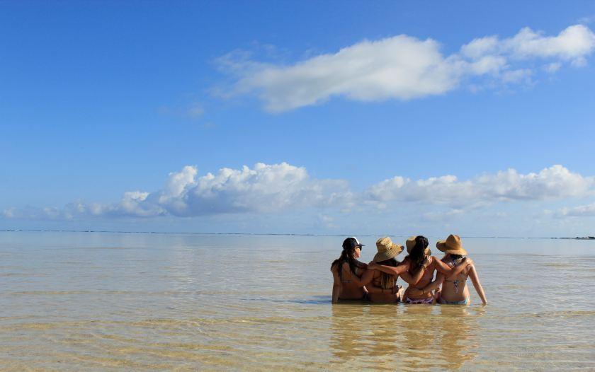 girls on the beach for a tropical bachelorette party
