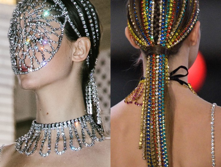 From Area- one model is a crystal-mesh face mask and the other model has her hair in a ponytail with different colored strands of rhinestones woven through.