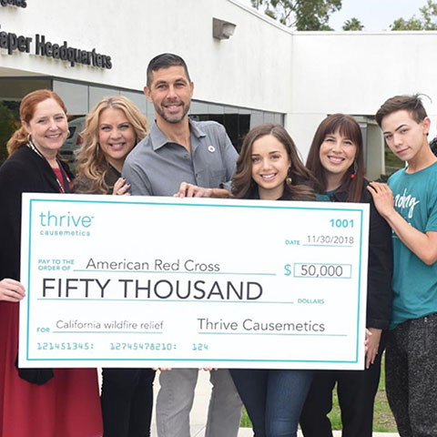 The team at Thrive presents the American Red Cross with $50,000 for California wildfire relief