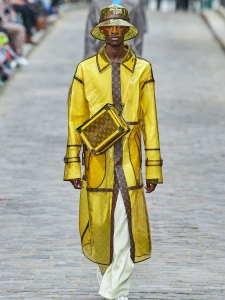 Model in yellow LV outfit walking down runway