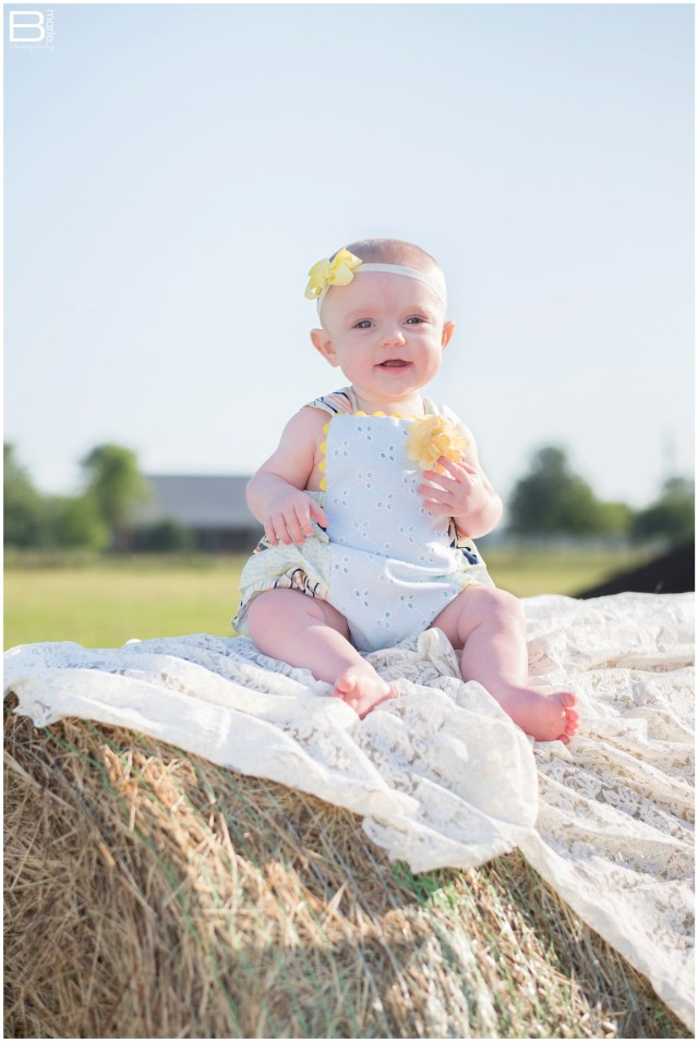Nacogdoches photographer 6 month old baby girl in a field filled with morning light