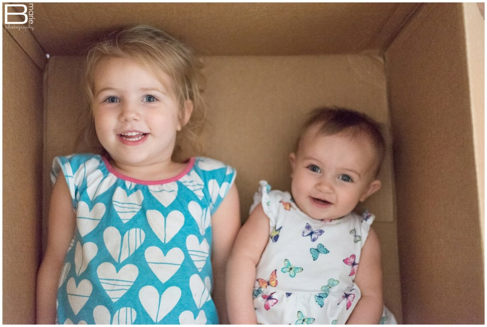Houston photographer images of daughters Peanut & Pumpkin for a personal monthly photo challenge - June installment in moving box