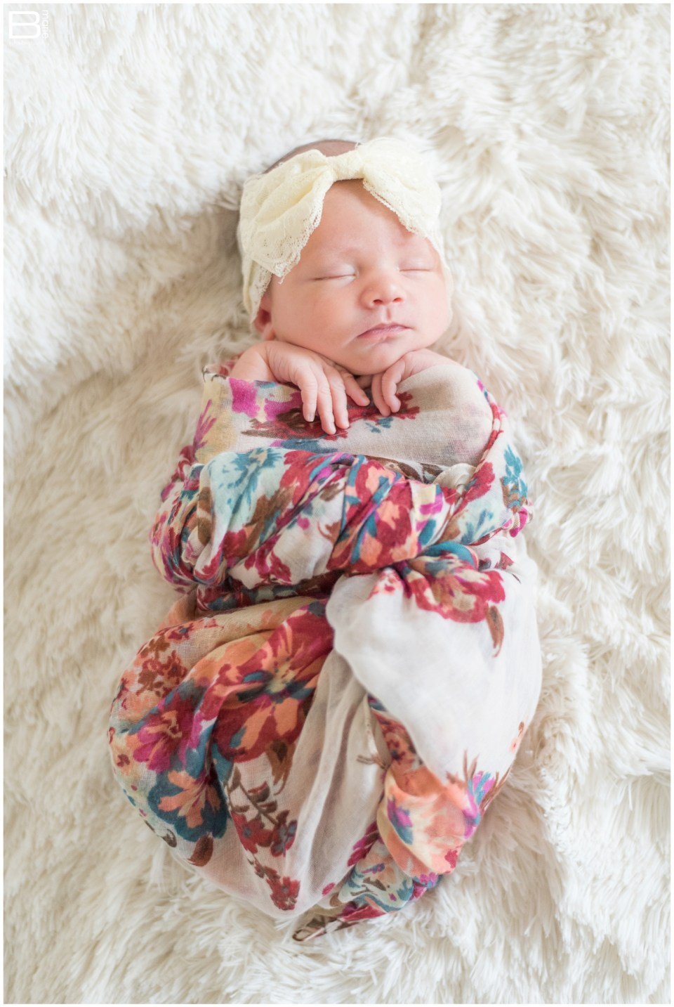 Newborn portraits of baby girl in feminine colors with in-home family portraits
