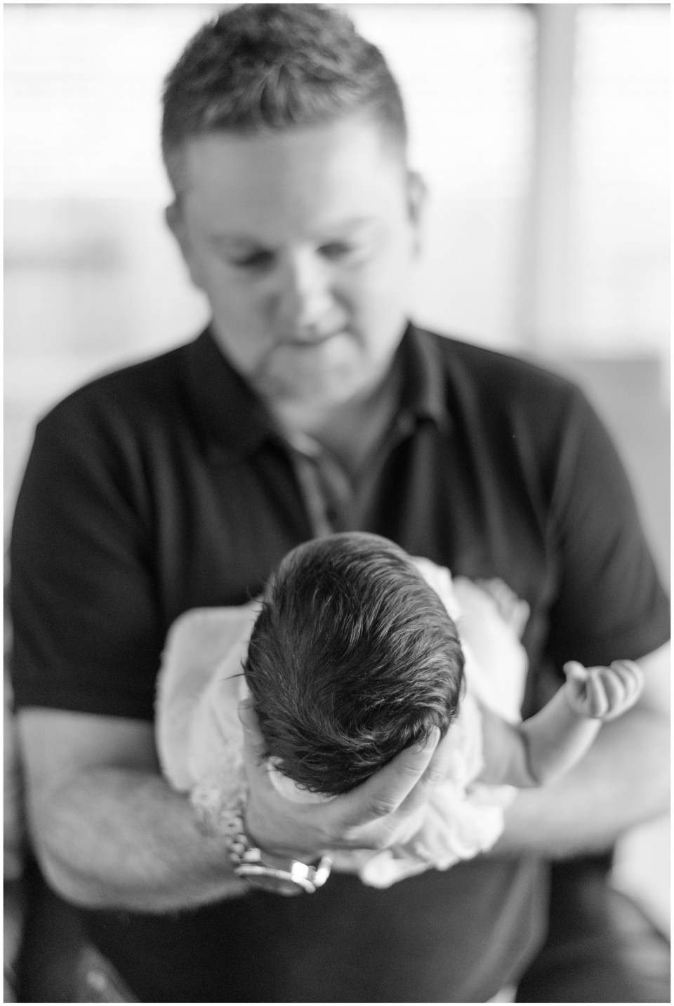 Kingwood family photographer images from an at-home newborn session with baby girl & her big sisterKingwood family photographer images from an at-home newborn session with baby boy & his big sisters