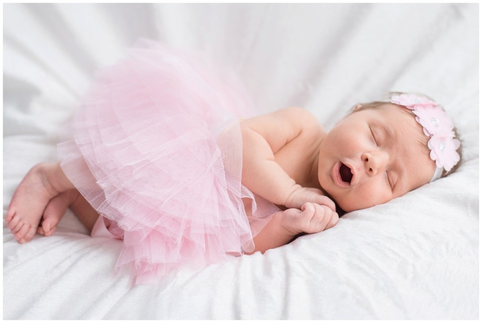 Kingwood photographer - baby girl posed and lifestyle newborn portrait session with white, cream, light peach, light blue tones and a pink tutu