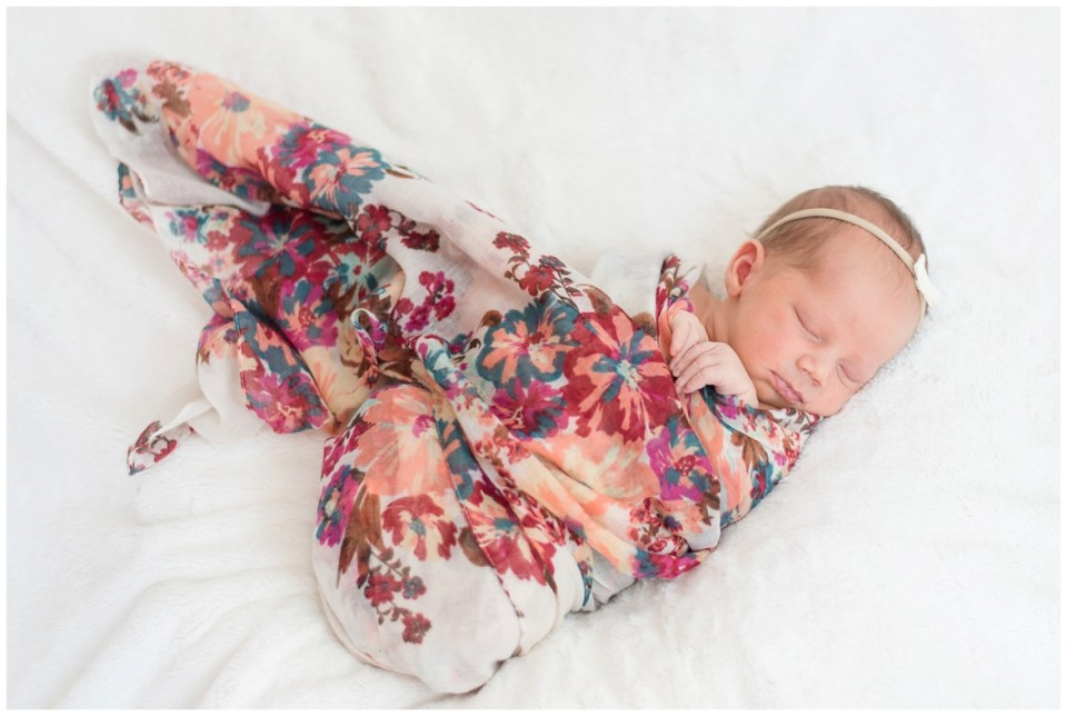 Kingwood photographer's at-home newborn portrait session with mix of lifestyle and posed portraits