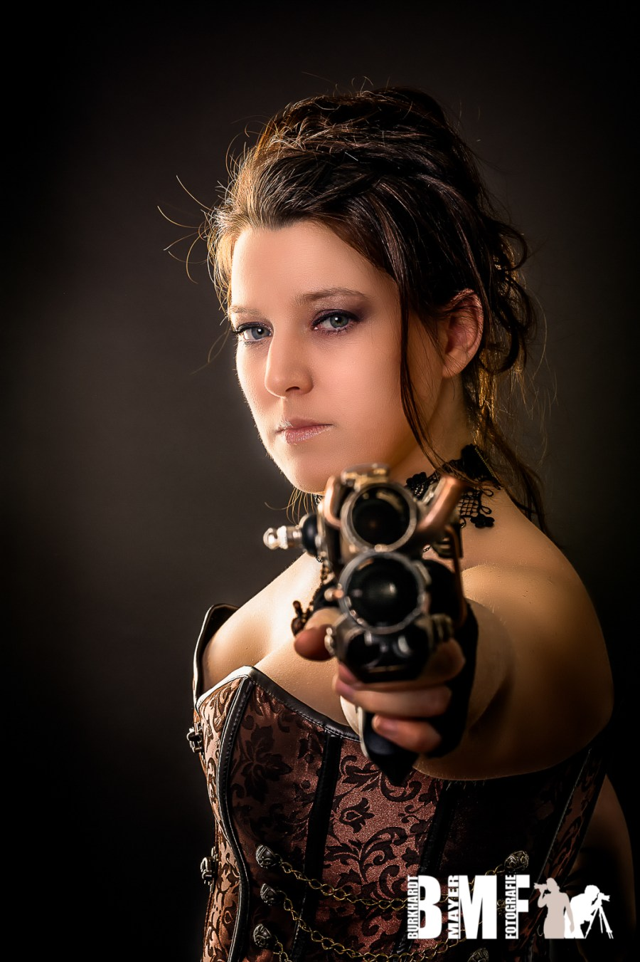 steam punk woman aiming with gun