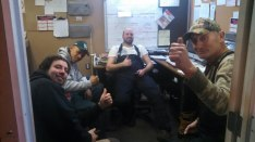 The crew gives a thumbs-up after a hard day of work.