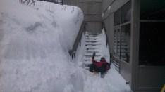 Eric Smith has some fun between shoveling.