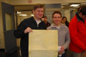 Sports Editor Liam Johansson '17 and Editor-in-Chief Sam Ravina '17 hold an old plate. Photo by Noa Schabes '17.