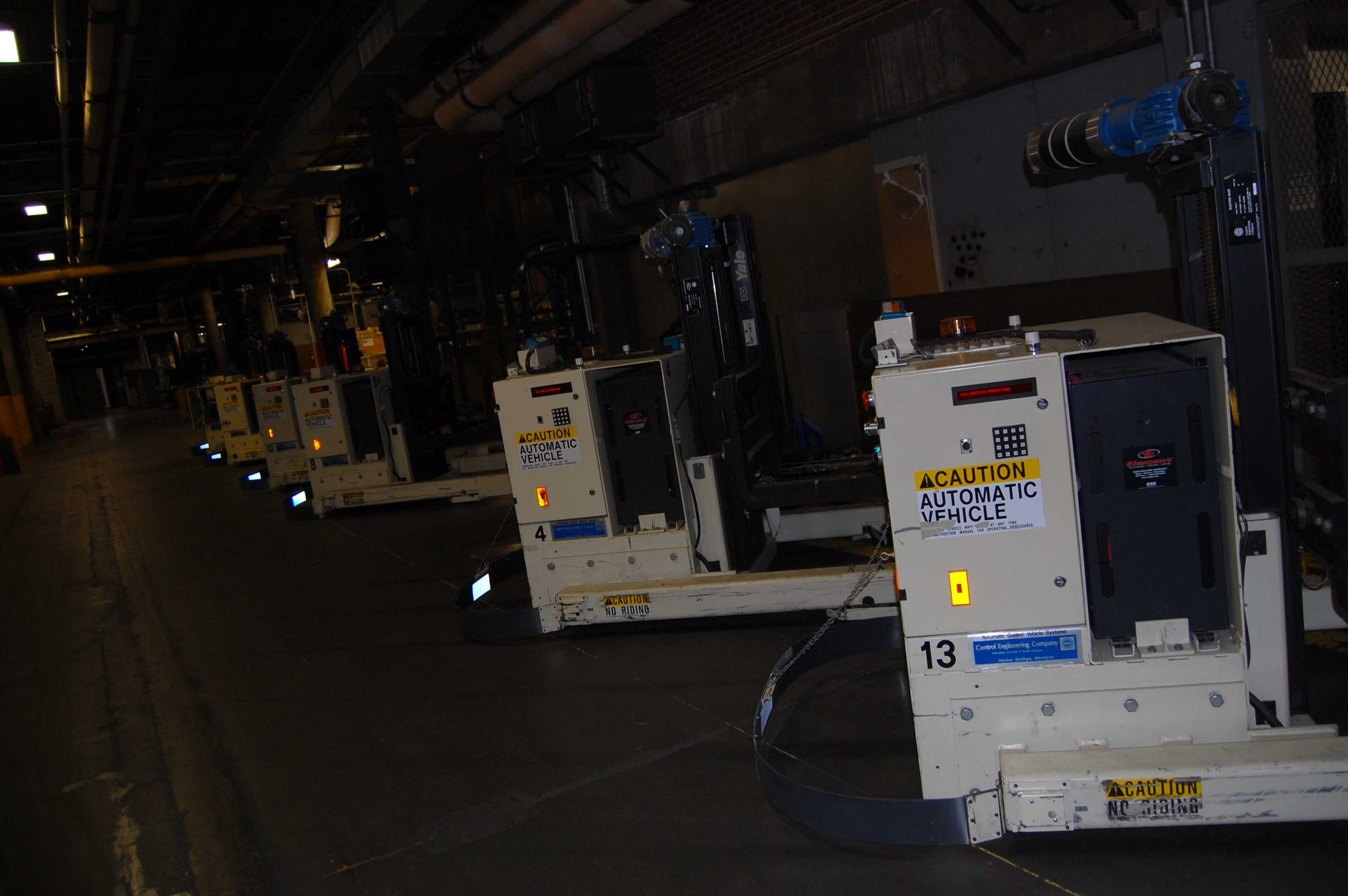 Automated machines used to lift and transport newspapers. Photo by Noa Schabes '17.