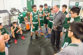 Coach Iuliano chats with Varsity II players. Photo by David Barron.