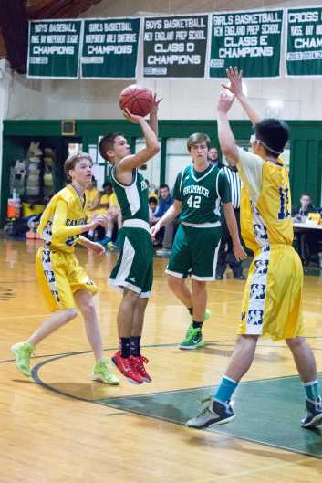 Jacob Quiles '16 takes a jumper. Photo by David Barron.