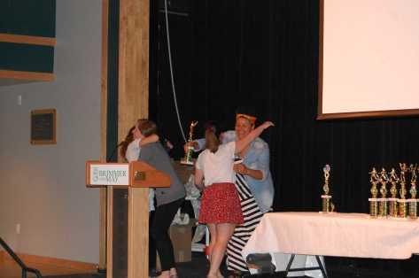 V. Lacrosse Coach's Award Winner Regina Carey hugs Coach Rawls.