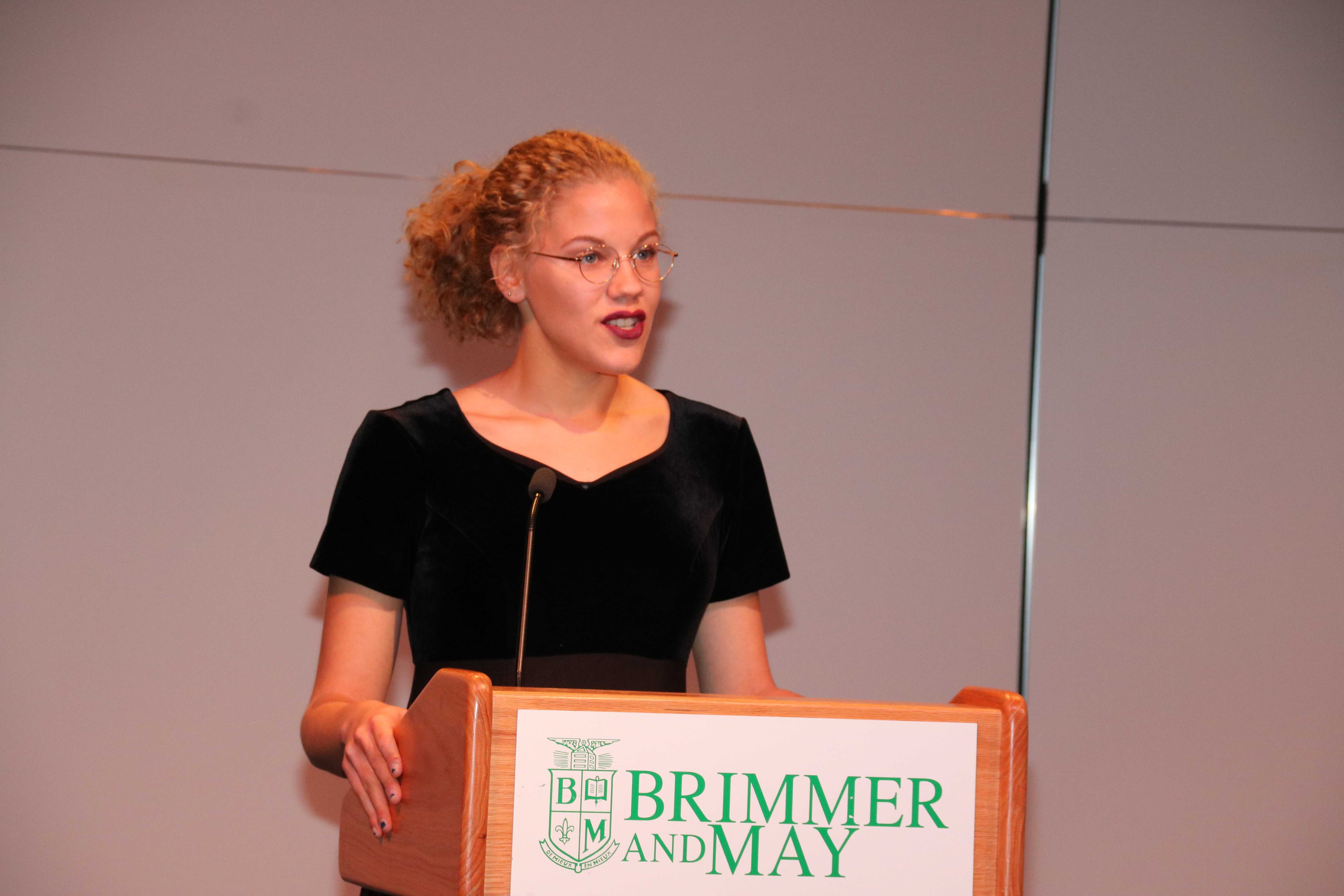 Photo by Jody Weinberg: Alexis Ifill '17 delivers address.