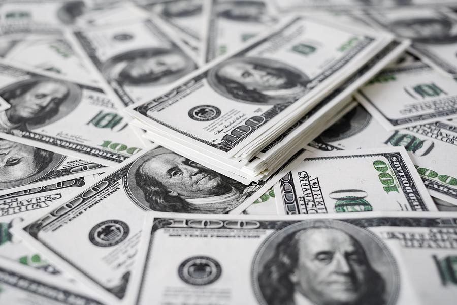 A+stack+of+money.+Heap+of+one+hundred+dollar+bills+on+money+background.+Fake+money.+Shallow+depth+of+field.+Selective+focus.+Photo+purchased+from+Bigstock.com.