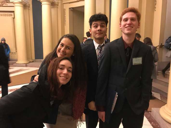 Delegates Chloe Berlin '20, Hannah Ahearn '20, Stephen Moreno '20, and Elias Kazan '20 get pumped for the opening ceremony. Photo by David Cutler '02.