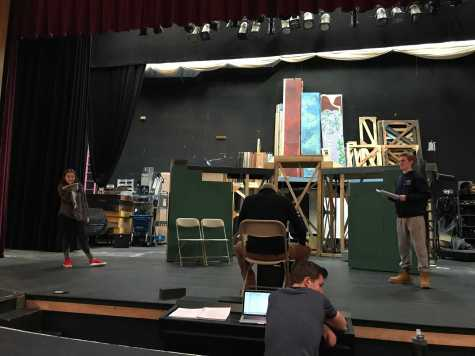 Bill Jacob, in his director's chair, blocks out scenes with actors. Photo by Elizabeth Foley '20.