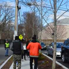 Students make their way to the front of the main parking lot. Photo by Michelle Levinger '19.