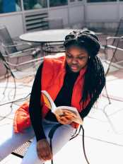 Ayanna Jefferson '22 reading outside of the learning commons.